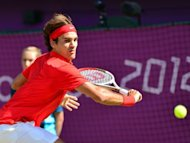 Switzerland's Roger Federer returns the ball to Great Britain's Andy Murray during the men's singles gold medal match