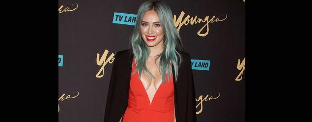 Hilary Duff red hot and on trend in deep V dress