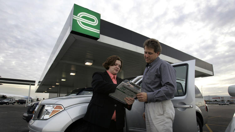 FILE - In this Monday, Nov. 6, 2006, file photo, Sarah Street of Enterprise Rent-A-Car goes over the rental contract with Joe Sanford of Huntsville, Ala., in Romulus, Mich. Enterprise Holdings, the nation's largest rental car company, plans to hire 11,000 new full-time workers by the middle of 2014, the company told The Associated Press on Wednesday, Oct. 2, 2013. (AP Photo/Carlos Osorio, File)