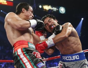 Juan Manuel Marquez and Manny Pacquiao trade blows. (AP)