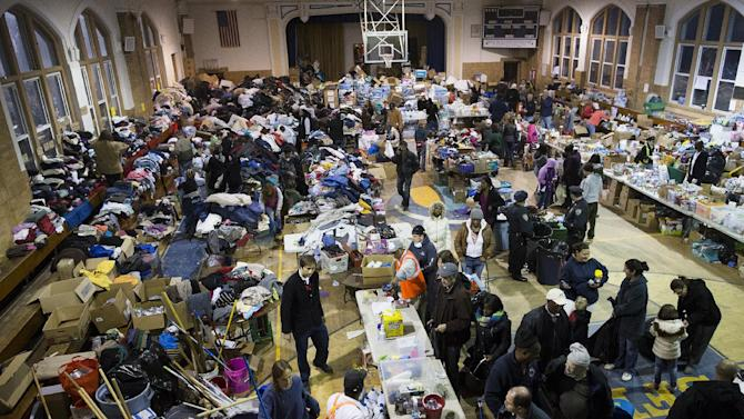 Donations are stored and distributed in the Saint Francis de Sales school gymnasium in the Rockaways, Saturday, Nov. 10, 2012, in the Queens borough of New York. Despite power returning to many neighborhoods in the metropolitan area after Superstorm Sandy crashed into the Eastern Seaboard, many residents of the Rockaways continue to live without power and heat due to damage caused by Sandy.(AP Photo/John Minchillo)