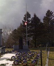 The flag at the Woods Harbour Fisherman's Memorial was lowered to half-mast on Wednesday.