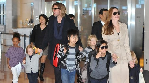 Brad Pitt, Angelina Jolie and their six children Maddox, Pax, Zahara, Shiloh, Knox, and Vivienne arrive at Haneda International Airport in Tokyo on November 8, 2011 -- Getty Premium