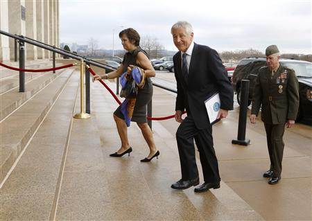 Former U.S. Senator Chuck Hagel (R-NE) (C) smiles as he and his wife Lilibet (L) arrive for his swearing-in and his first day as Secretary of Defense at the Pentagon in Arlington, Virginia, February 27, 2013. REUTERS/Jonathan Ernst
