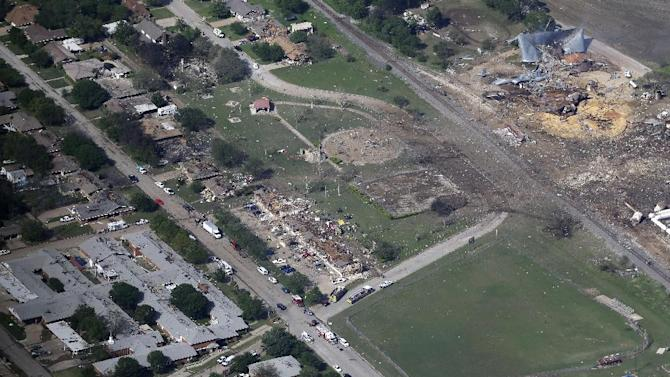 FILE - This Thursday, April 18, 2013 file aerial photo shows the remains of a nursing home, left, apartment complex, center, and fertilizer plant, right, destroyed by an explosion in West, Texas on April 17. Four weeks later, investigators have yet to announce what prompted the fire and touched off the massive explosion that killed 14 people. (AP Photo/Tony Gutierrez, File)