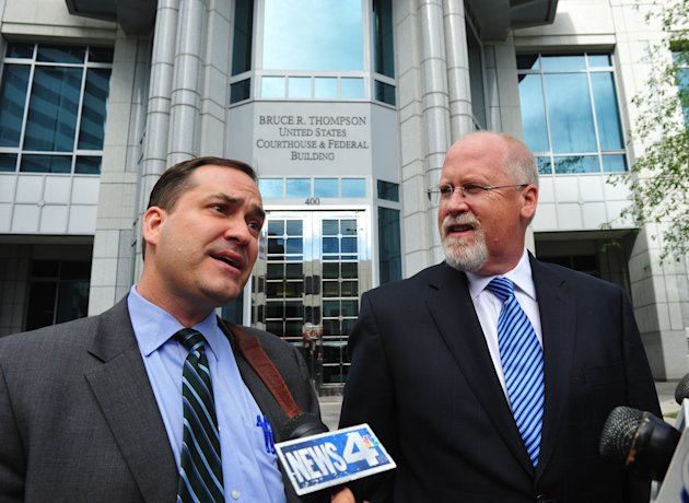 Defense attorney John Arrascada, left, with Harvey Whittemore at his side speak to the media after Whittemore's arraignment Thursday June 7, 2012 in Reno, Nev. Whittemore, a former developer and lobbyist with ties to Senate Majority Leader Harry Reid and Nevada's political elite pleaded not guilty Thursday to federal charges involving campaign contributions. (AP Photo/The Reno Gazette-Journal, Tim Dunn) NEVADA APPEAL OUT; NO SALES