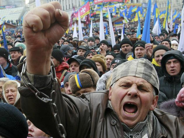 A man shouts slogans during a rally organized by supporters of EU integration at Maidan Nezalezhnosti or Independence Square in central Kiev