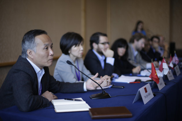 Vietnamese trade official Tran Quoc Khanh, left, speaks during a news conference at the Trans-Pacific Partnership Free Trade Agreement talks Tuesday, July 10, 2012, in San Diego. Negotiators from the United States and eight Pacific Rim countries have concluded a round of talks in San Diego aimed at creating one of the most ambitious trade agreements in decades. (AP Photo/Gregory Bull)