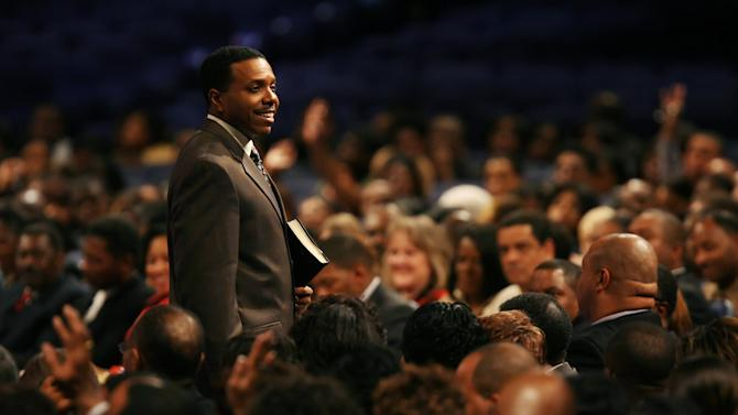 "In this Wednesday, Nov. 7, 2007 photo, Rev. Creflo Dollar gives his Wednesday night service at World Changers Church International, in College Park, Ga. Dollar has been arrested after authorities say he slightly hurt his 15-year-old daughter in a fight at his metro Atlanta home. Fayette County Sheriff's Office investigator Brent Rowan says deputies responded to a call of domestic violence at the home around 1 a.m. Friday, June 8, 2012. Rowan says the 50-year-old pastor and his daughter were arguing over whether she could go to a party when Dollar ""got physical"" with her, leaving her with ""superficial injuries."" (AP Photo/Atlanta Journal-Constitution, Pouya Dianat) MARIETTA DAILY OUT; GWINNETT DAILY POST OUT; LOCAL TV OUT; WXIA-TV OUT; WGCL-TV OUT"
