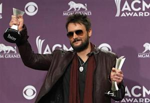 Eric Church holds his awards for album of the year and vocal event of the year at the 48th ACM Awards in Las Vegas