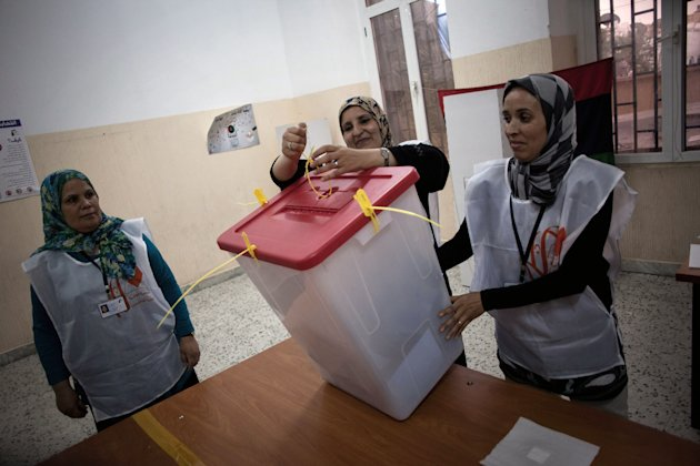 Polling station officials count ballots at a polling station in Tripoli, Libya, Saturday, July 7, 2012. Jubilant Libyans chose a new parliament Saturday in their first nationwide vote in decades, but violence and protests in the restive east underscored the challenges ahead as the oil-rich North African nation struggles to restore stability after the ouster of longtime dictator Moammar Gadhafi. (AP Photo/Manu Brabo)