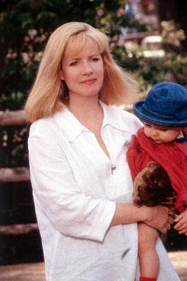 Megan Dayton ( Bonnie Hunt ) is Grace's best friend in MGM's Return To Me