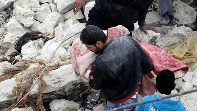 This citizen journalism image provided by Aleppo Media Center AMC which has been authenticated based on its contents and other AP reporting, shows a Syrian man carrying a child's body in the aftermath of a strike by Syrian government, in the neighborhood of Jabal Bedro, in Aleppo, Syria, Tuesday Feb. 19, 2013. The Britain-based activist group Syrian Observatory for Human Rights and the Aleppo Media Center reported several dead in the attack late Monday night, saying the strike appeared to be from a ground-to-ground missile. (AP Photo/Aleppo Media Center AMC)