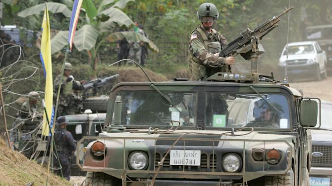 "FILE - In this Saturday, March 3, 2007 file photo, a convoy of armed U.S. humvees stop as goats pass by during the closing ceremonies of the annual military exercises called ""Balikatan,"" or ""shouldering the load together,"" at the coastal village of Bato-Bato in Indanan town, Jolo province, southern Philippines. After more than a decade of helping fight al-Qaida-linked militants, the United States is disbanding an anti-terror contingent of hundreds of elite American troops in the southern Philippines where armed groups such as Abu Sayyaf have largely been crippled, officials said Thursday. (AP Photo/Aaron Favila, File)"