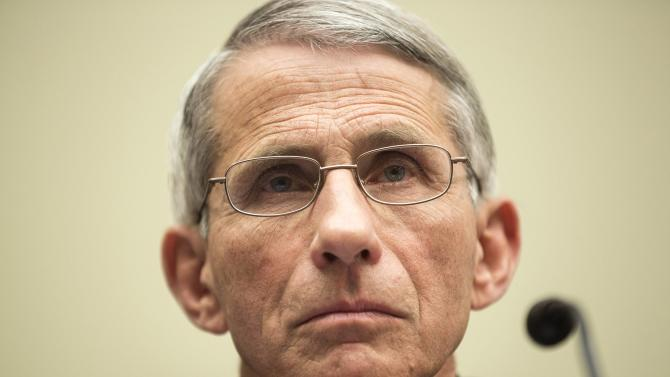 "Fauci, director of the National Institute of Allergy and Infectious Diseases, prepares to testify before a House Foreign Affairs Subcommittee hearing on ""global efforts to fight Ebola"" on Capitol Hill in Washington"