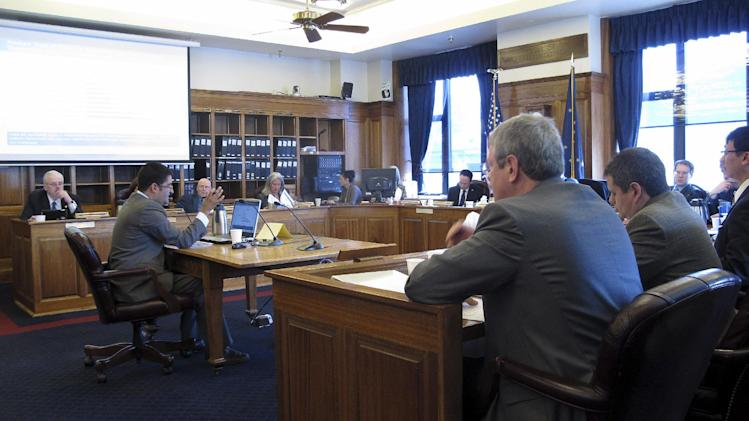 Consultant Janak Mayer testifies before the House Resources Committee and House Special Committee on Energy on Monday, April 23, 2012, in Juneau, Alaska. Mayer, at the center table, testified on the governor's oil tax bill. (AP Photo/Becky Bohrer)