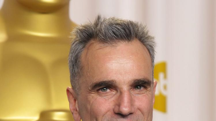 """Daniel Day-Lewis  poses with his award for best actor in a leading role for """"Lincoln"""" during the Oscars at the Dolby Theatre on Sunday Feb. 24, 2013, in Los Angeles. (Photo by John Shearer/Invision/AP)"""
