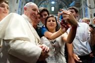 """FILE - In this file photo Wednesday, Aug. 28, 2013 Pope Francis has his picture taken inside St. Peter's Basilica with youths from the Italian Diocese of Piacenza and Bobbio who came to Rome for a pilgrimage, at the Vatican, Wednesday, Aug. 28, 2013. """"Selfie"""" the smartphone self-portrait has been declared word of the year for 2013 by Britain's Oxford University Press. (AP Photo/L'Osservatore Romano, File)"""