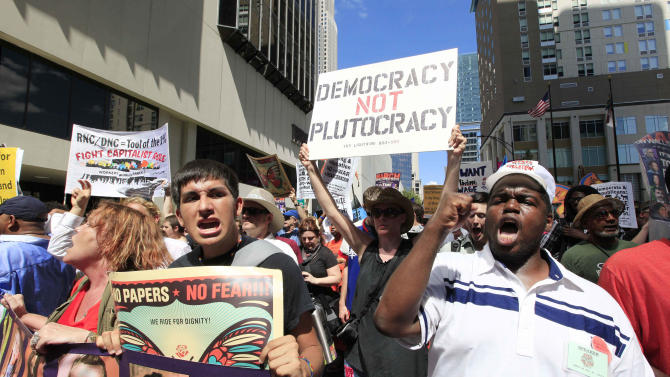 Demonstrators walk during a protest march, Sunday, Sept. 2, 2012, in Charlotte, N.C. Demonstrators are protesting before the start of the Democratic National Convention. (AP Photo/Chuck Burton)