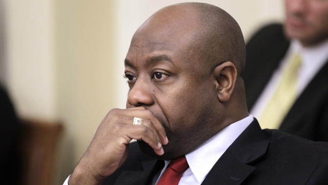 FILE - In this Jan. 6, 2011, file photo, Rep. Tim Scott, R-S.C. listens at a House Rules committee meeting, on Capitol Hill in Washington.  A Washington GOP official says South Carolina Gov. Nikki Haley has chosen Rep. Tim Scott to replace Jim DeMint in the Senate.  (AP Photo/Charles Dharapak, File)