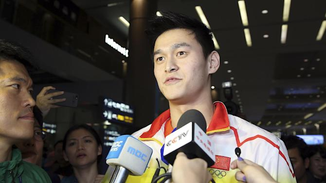 FILE - In this Sept. 16, 2014 file photo, star swimmer Sun Yang talks to the media as he arrives for Asian Games at Incheon International Airport in Incheon, South Korea, Tuesday, Sept. 16, 2014. Olympic and world champion swimmer Sun served a three-month ban earlier this year after testing positive for a banned stimulant, China's anti-doping agency disclosed Monday, Nov. 24. (AP Photo/Yonhap, Han Jong-chan, File)  KOREA OUT