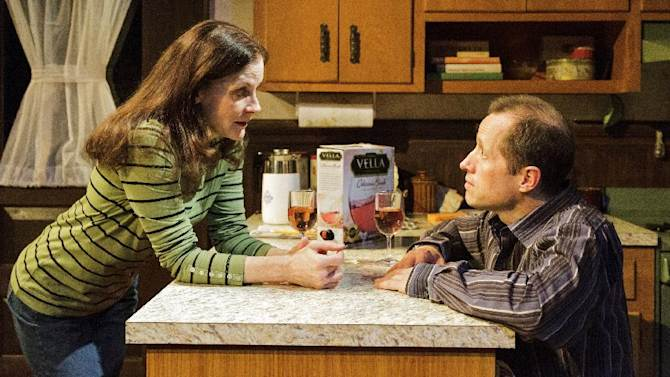 """This theater image released by Keith Sherman & Associates shows Hallie Foote, left, and Tim Hopper in a scene from Daisy Foote's play, """"Him,"""" currently performing off-Broadway at Primary Stages in New York.  (AP Photo/Keith Sherman & Associates, James Leynse)"""