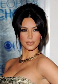 Do you think Kim Kardashian's lips are plumped up frrom injections, or because she has the flu? / Getty Images