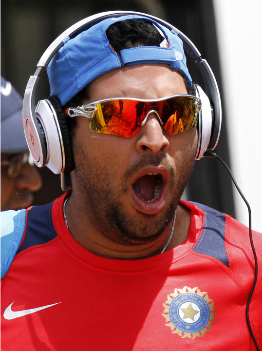 India's Yuvraj Singh yawns as he arrives for a practice session ahead of their Cricket World Cup Group B match with Kenya in Chennai, India, Wednesday, March 16, 2011. (AP Photo/Gurinder Osan)