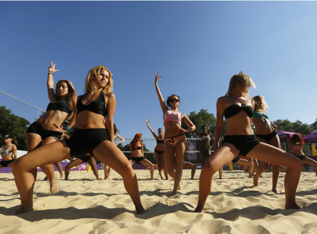 Dancers rehearse their performances for the London 2012 Olympic Beach Volleyball matches in London