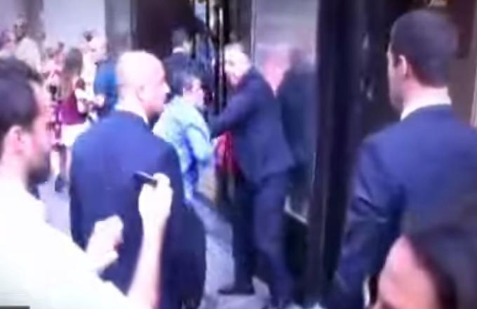 "Donald Trump's Bodyguard Hit a Protester in the Face After Taking His Hilarious ""Make America Racist Again"" Banner"