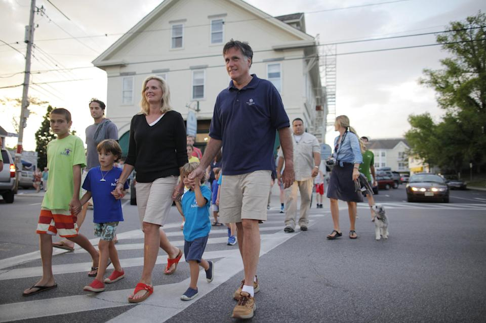 Republican presidential candidate Mitt Romney, and wife Ann, walk with their grandchildren across Main Street in Wolfeboro, N.H., Monday, July 2, 2012, as they continue their vacation from the campaign trail. (AP Photo/Charles Dharapak)