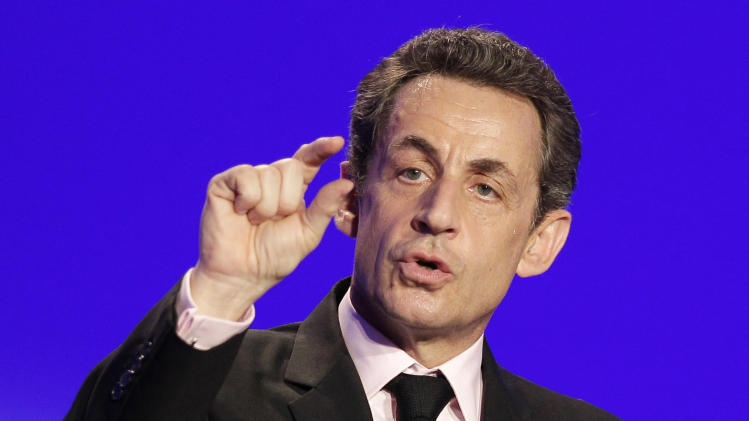 France's President  and candidate for re-election in 2012, Nicolas Sarkozy, gestures as he delivers a speech during a meeting in Ormes, France, Monday, March 26, 2012. (AP Photo/Michel Euler)