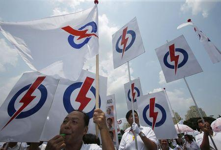 Singapore's People's Action Party (PAP) supporters cheer for their candidates during nomination day ahead of the general elections in Singapore