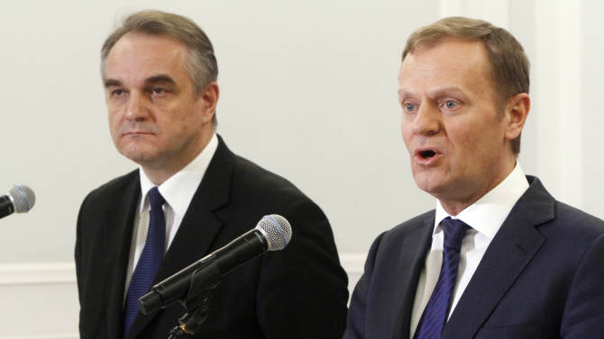 Poland's Prime Minister Donald Tusk, right, and Deputy Prime Minister Waldemar Pawlak announce a compromise on how to overhaul the pension system, in Warsaw, Poland, on Thursday, March 29, 2012. Tusk, with the pro-market Civic Platform party, wanted to raise the retirement age to 67 for all Poles from 60 for women and 65 for men to help bring down state spending. Pawlak's more welfare-oriented Polish Peoples' Party felt that was too harsh and managed to water the plan down somewhat. Under the deal reached Thursday, women will be able to start drawing on retirement payments at 62 and men at 65, but would need to work part time and would get only half their normal pension. (AP Photo/Czarek Sokolowski)