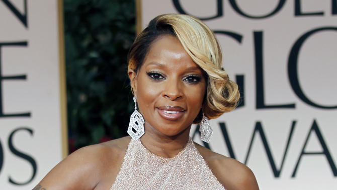 """FILE - In this Jan. 15, 2012 file photo, singer Mary J. Blige arrives at the 69th Annual Golden Globe Awards in Los Angeles. A criticized Burger King commercial featuring Mary J. Blige singing about chicken has been pulled, but the fast-food chain is blaming licensing issues for the decision. In it, Blige sings passionately about the ingredients in the chicken snack wraps. But as the video went viral, some in the black community criticized the ad as stereotypical. The black women-oriented website Madame Noire likened it to """"buffoonery."""" Burger King said Tuesday the commercial was pulled because of a music licensing concern and that they hope to have the Blige """"ads back on the air soon."""" (AP Photo/Matt Sayles, file)"""