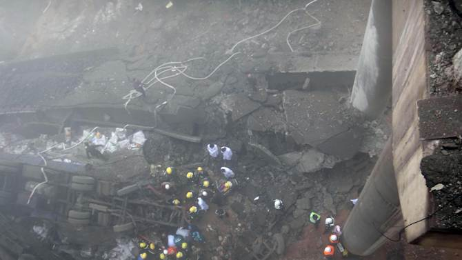 In this photo provided by China's Xinhua News Agency, rescuers work at the accident site where an expressway bridge partially collapsed due to a truck explosion in Mianchi County, Sanmenxia, central China's Henan Province, Thursday, Feb. 1, 2013.  Fireworks for Lunar New Year celebrations exploded on a truck in central China, destroying part of an elevated highway Friday and sending vehicles plummeting 30 meters (about 100 feet) to the ground. State media had conflicting reports on casualties.  (AP Photo/Xinhua, Xiao Meng) NO SALES