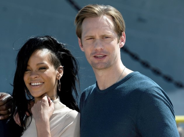 Rihanna and Alexander Skarsgard attend the &#39;Battleship&#39; Photo Call at the Battleship Missouri Memorial, Pearl Harbor, Oahu, Hawaii, on April 28, 2012  -- Getty Images