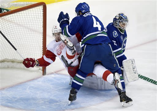 Canucks beat Wings in SO to clinch playoff spot
