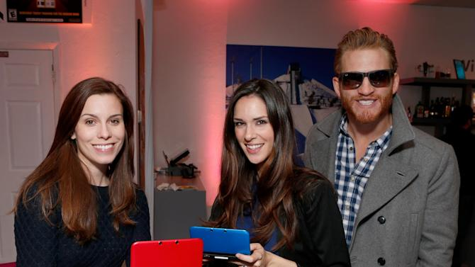 From left, actors Lauren Reeder, Katie Savoy and Brent Chase warm up and check out Nintendo 3DS XL at the Nintendo Lounge during a break from the Sundance Film Festival on Saturday, January 20, 2013 in Park City, UT. (Photo by Todd Williamson/Invision for Nintendo/AP Images)