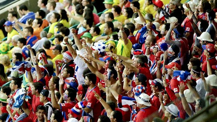 Costa Rica fans cheer during the World Cup quarterfinal soccer match between the Netherlands and Costa Rica at the Arena Fonte Nova in Salvador, Brazil, Saturday, July 5, 2014