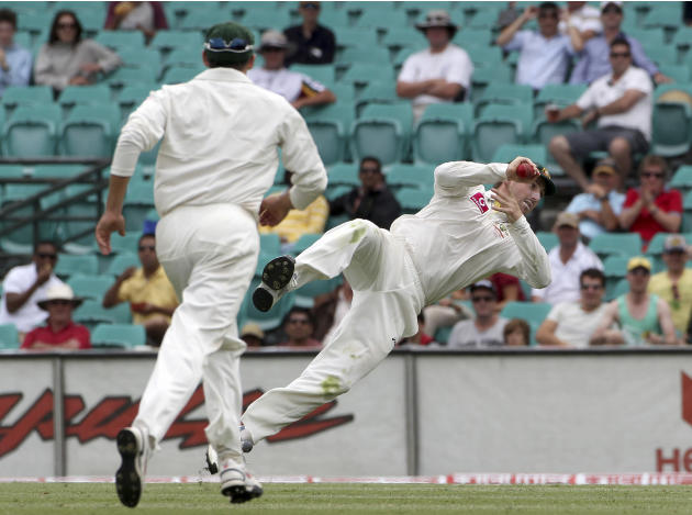 Australia's Shaun Marsh flies high as he catches out India batsman Zaheer Khan on day 4 of the second test match at the Sydney Cricket Ground in Sydney, Australia, Friday, Jan. 6, 2012. (AP Photo/Rob