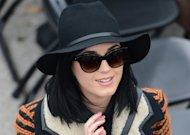 Singers Katy Perry arrives to be seated for the 57th Presidential Inauguration on January 21, 2013 at the US Capitol in Washington, DC. The Pop princess was a starlet in stripes Monday, bundling up in the chill as she joined a bevy of celebrities at Barack Obama's second presidential inauguration