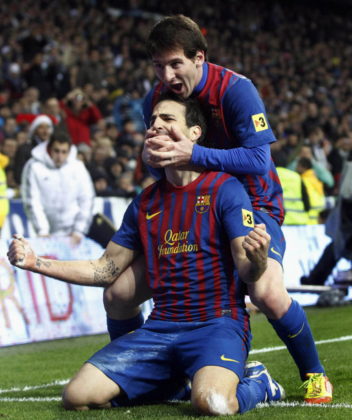 Barcelona's Messi celebrates a goal with teammate Fabregas against Real Madrid during their Spanish first division soccer match in Madrid