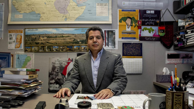 Dr. Najib Ghadbian sits in his office at the University of Arkansas. Ghadbian was recently named a Syrian opposition representative for the United States. Ghadbian will be taking a leaving of absence from the University of Arkansas until September. (AP Photo/Gareth Patterson)