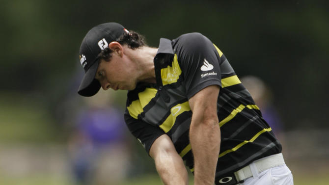Rory McIlroy, of Northern Ireland, hits from the seventh fairway at the St. Jude Classic golf tournament on Saturday, June 9, 2012, in Memphis, Tenn. (AP Photo/Mark Humphrey)