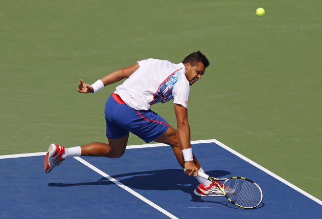 France&#39;s Jo-Wilfried Tsonga returns a shot to Slovakia&#39;s Martin Klizan in the second round of play at the 2012 US Open tennis tournament, Thursday, Aug. 30, 2012, in New York. Fifth-seeded Tsonga was upset by Klizan in the second round. (AP Photo/Paul Bereswill)
