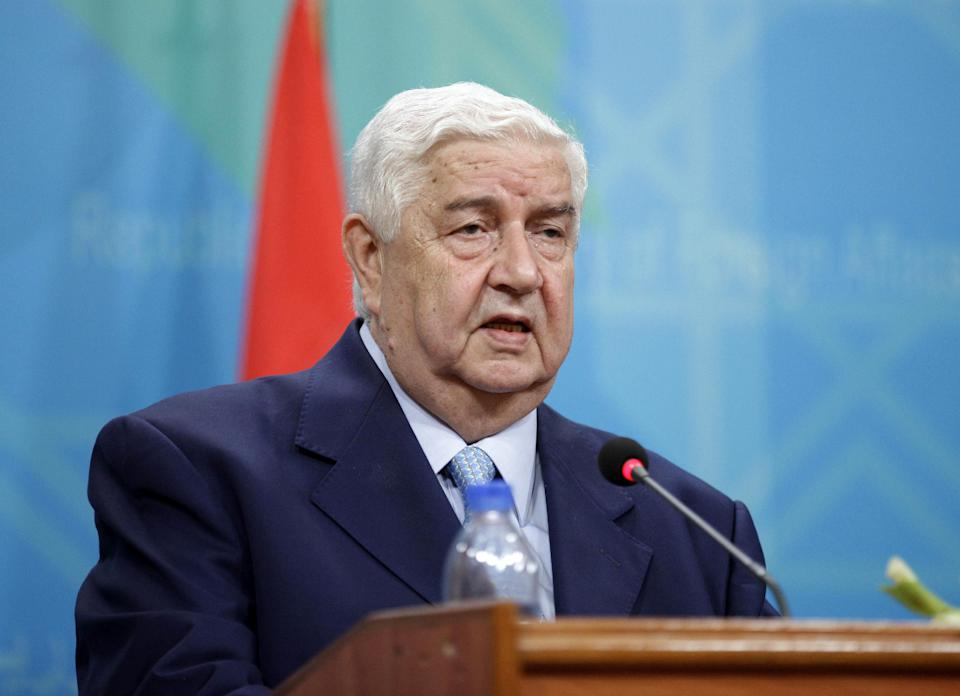 Syrian Foreign Minister Walid Moallem attends a press conference with his Iraqi counterpart, Hoshyar Zebari, not pictured, in Baghdad, Iraq, Sunday, May 26, 2013. (AP Photo/Hadi Mizban, Pool)