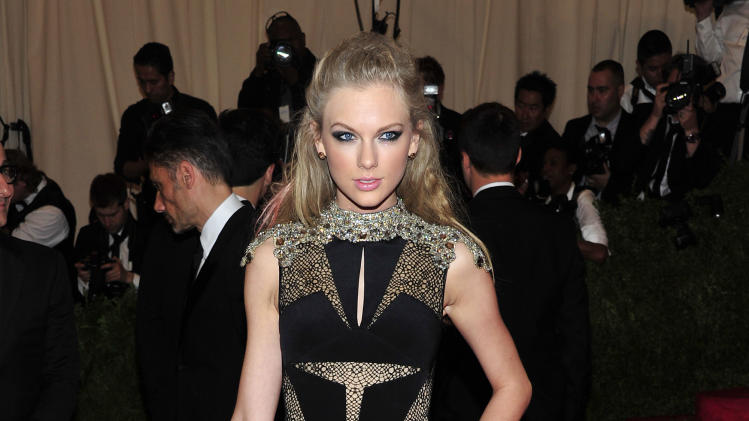 "Taylor Swift attends The Metropolitan Museum of Art's Costume Institute benefit celebrating ""PUNK: Chaos to Couture"" on Monday May 6, 2013 in New York. (Photo by Charles Sykes/Invision/AP)"