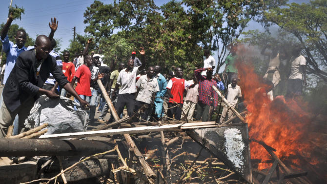 Demonstrators set up burning tyre roadblocks to protest the results of the Orange Democratic Movement (ODM) primary elections, in the town of Ahero near Kisumu in western Kenya Sunday, Jan. 20, 2013. Political parties in Kenya this week held their internal elections to decide candidates who will vie for gubernatorial, senate, county, and women representatives seats in the upcoming March 4 elections, a process which was fraught with irregularities, disorganization and disgruntled losers, increasing the chances of conflict during the upcoming vote, analysts said on Friday. (AP Photo)