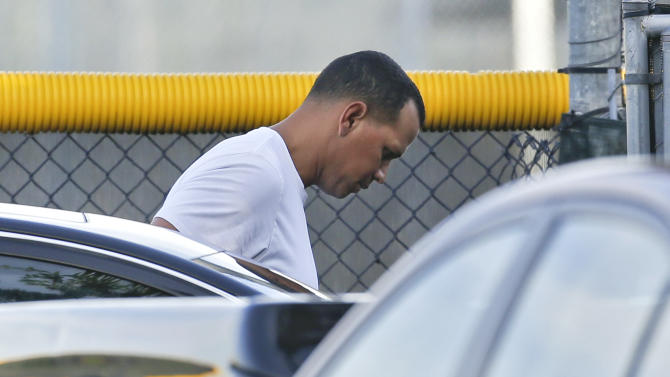 New York Yankees third baseman Alex Rodriguez arrives to workout at the Yankees minor league complex Thursday, Aug. 1, 2013, in Tampa, Fla. Major League Baseball is threatening to kick A-Rod out of the game for life unless the New York star agrees not to fight a lengthy suspension for his role in the sport's latest drug scandal, according to a person familiar with the discussions. The person spoke to The Associated Press on Wednesday, July 31, 2013 on condition of anonymity because no statements were authorized. (AP Photo/Chris O'Meara)